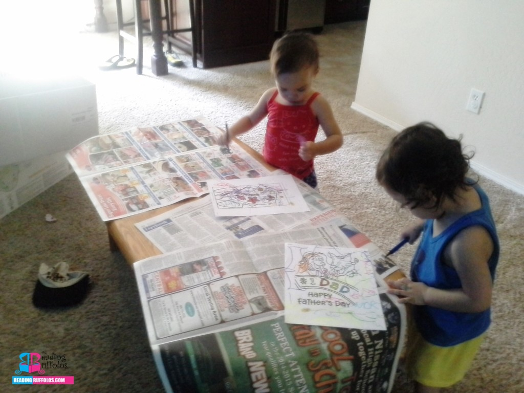 Newspaper covering the table to prevent major colored pen mess.