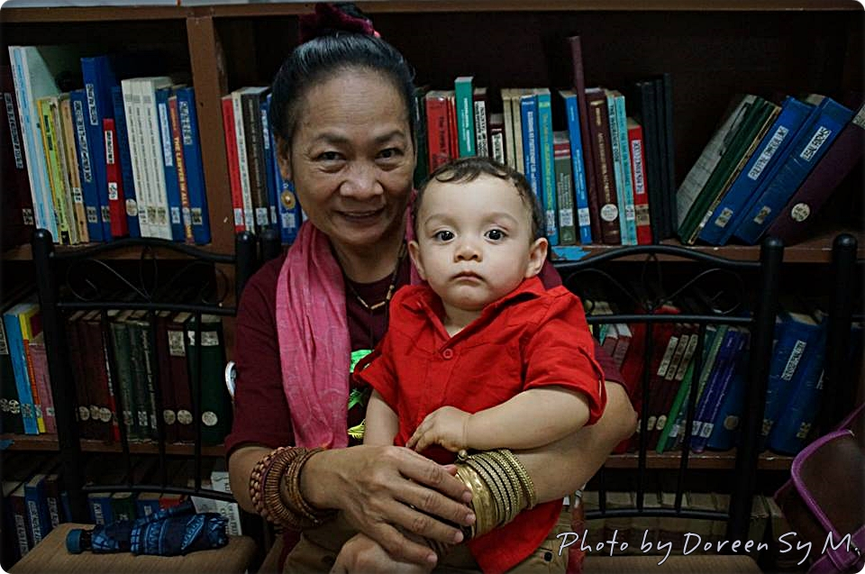 Miss Gaying with my son, Nicholas, during the launching of the Basadours' Project I Love to Read More in 2014.